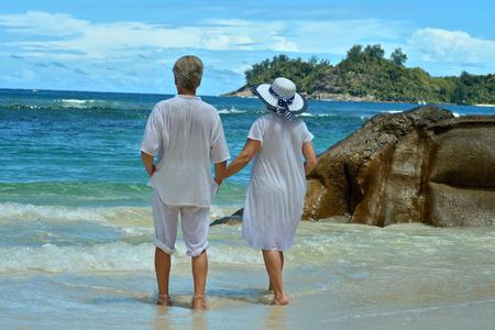 elderly: Happy elderly couple rest at tropical resort