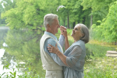 male senior adult: Happy Mature couple  dancing in the park in summer day Stock Photo