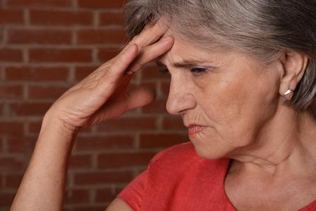 portrait of a sweet elderly woman in a red dress