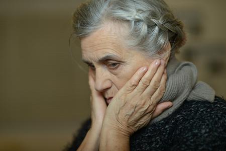 Portrait of a cute sad aged woman