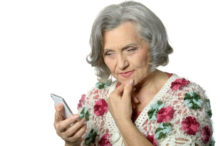 woman middle age: Portrait of elderly lady holding mobile phone and take a picture on white background
