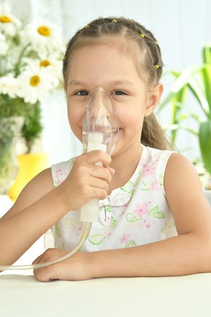 inhalation: Portrait of  Beautiful little girl with  mask for inhalation