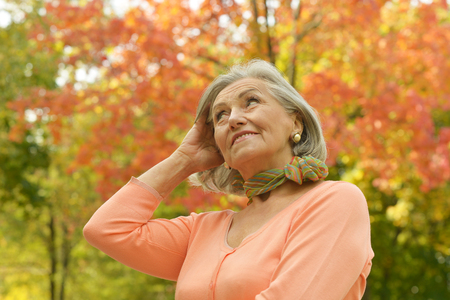 middleaged: Autumn portrait of a beautiful middle-aged woman on the nature Stock Photo