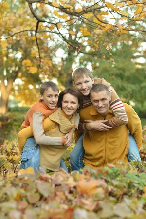 happy family: Portrait of happy family relaxing in autumn park Stock Photo