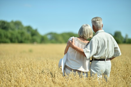 back  view: Loving mature couple in field  at summer,back view Stock Photo