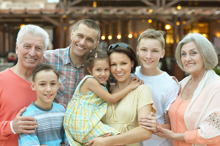 family portrait: Portrait of a happy family relaxing at vacation resort
