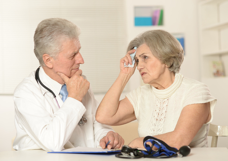 medical man: Portrait of a doctor with a patient Stock Photo