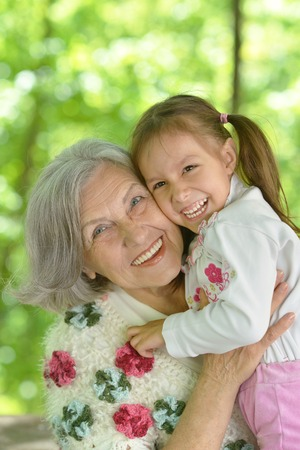 grandmother: Grandmother with her granddaughter in summer  park Stock Photo