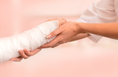 human arm: Female Doctor and young boy with a broken arm Stock Photo