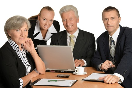 white work: Businesspeople at work with laptop on white background