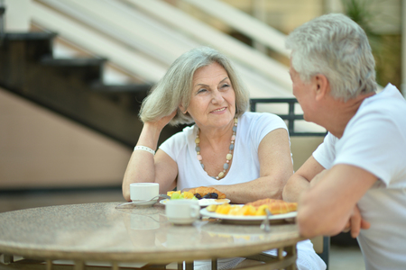 old people: Portrait of a amusing old couple in cafe Stock Photo