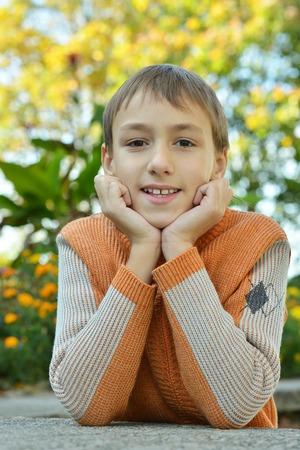 lovable: Lovable little boy smiling in autumn park Stock Photo