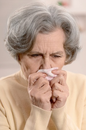handkerchief: Old woman with a handkerchief at home