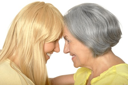 mam: Portrait of Senior woman with daughter on white background Stock Photo