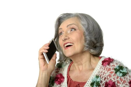 lady on phone: Portrait of elderly lady with mobile phone on white background Stock Photo
