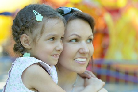 mam: Little cute girl with her mother in summer park Stock Photo
