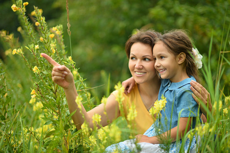 mother and teen daughter: Happy mother and daughter at summer field Stock Photo