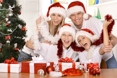 christmas tree presents: Portrait of a family celebrating New Year at home