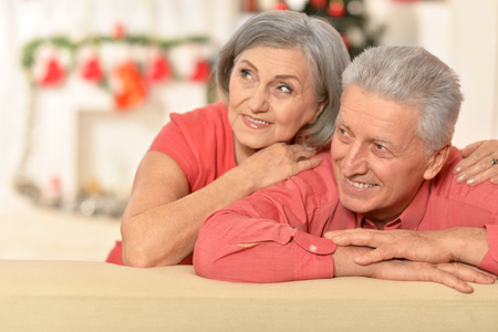 old people: Amusing old couple wearing Christmas holiday caps Stock Photo