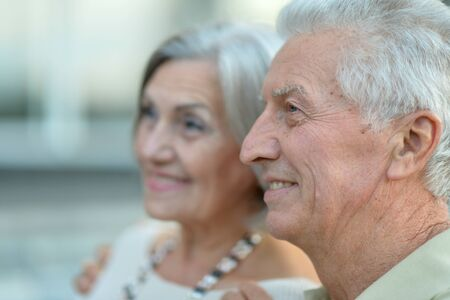 retirement: Happy nice mature couple walking in town
