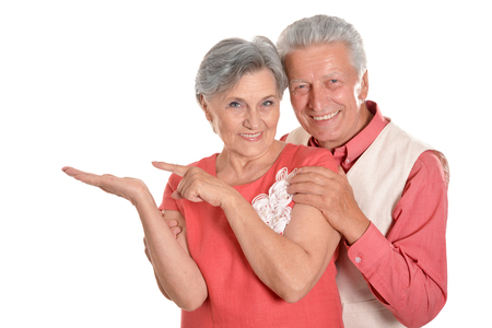 elderly: Elderly couple pointing on a white background Stock Photo