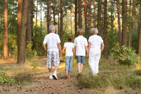 grandparents: Grandparents and grandchildren together in summer park