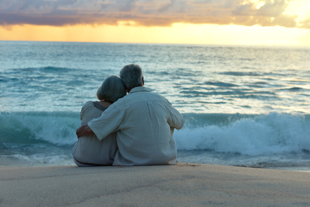 romantic beach: Beautiful happy elderly couple rest at tropical resort,back view