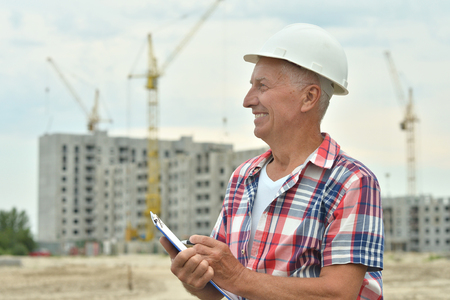 site construction: Portrait of senior  man  in under construction Stock Photo