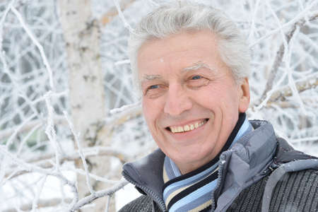 winter park: Portrait of an elderly man in winter outdoors
