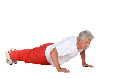 exercitation: Elderly man exercising on a white background Stock Photo