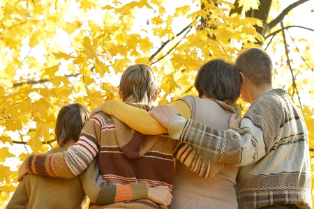 family fall: Portrait of family in autumn park,back view Stock Photo