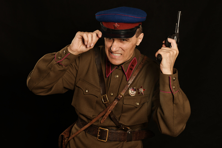 colonel: Colonel commander with a gun on a dark background