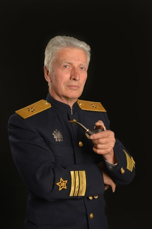 colonel: Military mature general on a black background