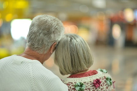 backside: Beautiful elderly couple backside in shopping mall Stock Photo