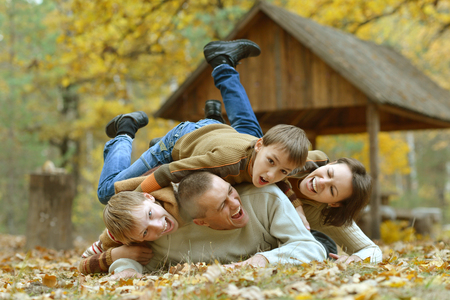 portrait couple: Portrait of beautiful family  in autumn forest Stock Photo