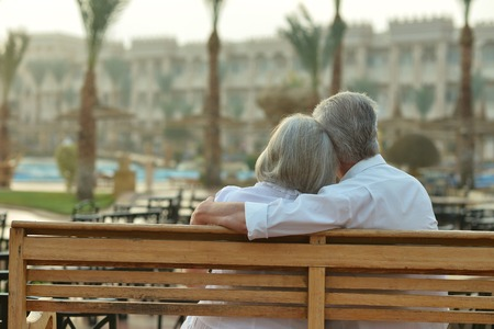 adult couple: Happy Mature couple enjoy fresh air and stunning view on vacation Stock Photo