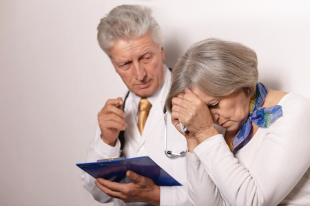came: Sad  elderly woman came to the doctor