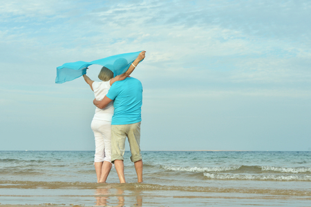 older couple: Happy Mature couple enjoy fresh air on beach Stock Photo