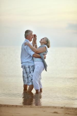 fresh air: Happy Mature couple enjoy fresh air on beach Stock Photo