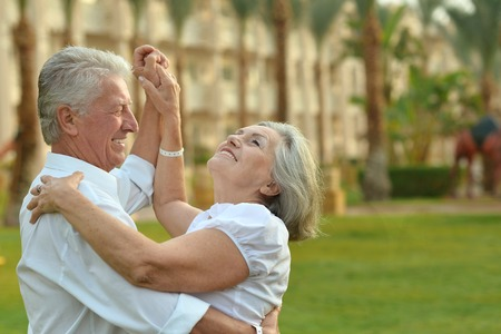 older women: Happy Mature couple in love enjoy vacation Stock Photo