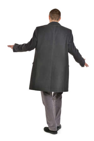 threw: Man in coat threw up his hands ,full length ,back view on a white background