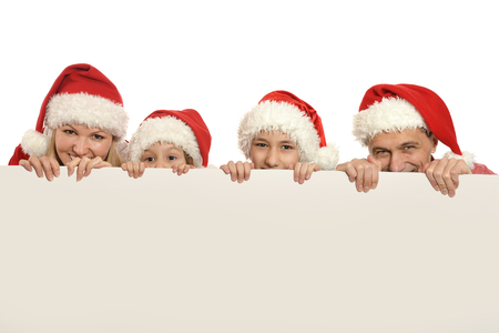 family with kids   in santa hats with white blank