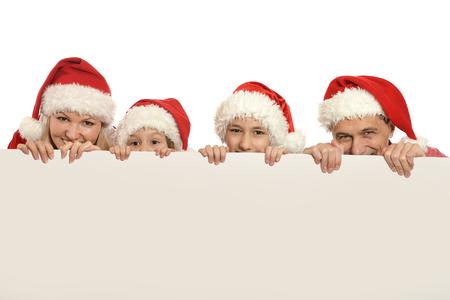 gezin met kinderen in santa hoeden met witte lege