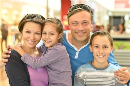 teen boy: Portrait of a happy family  walking in city