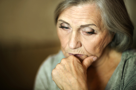 one senior: Portrait of a thoughtful sad elderly woman Stock Photo