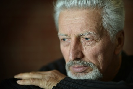 pensive man: Portrait of Sad senior man at home Stock Photo