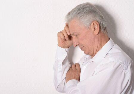 Portrait of sad senior man on white background