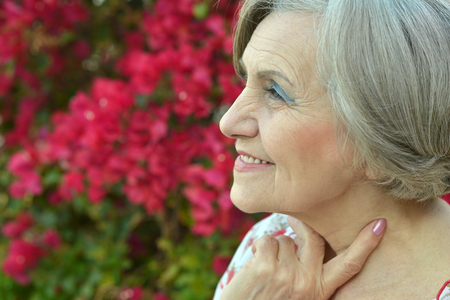 Portrait of a beautiful older woman with flowers