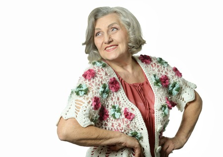 posing  agree: Portrait of elderly woman showing thumbs up on white background