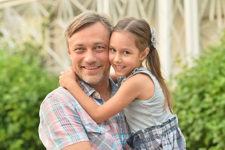 father with child: Happy father with daughter in summer park